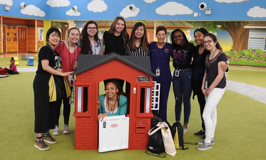 Volunteers in play house