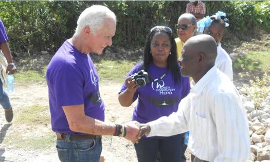 Harris Rosen shaking hands with man in Haiti