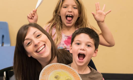 Kids with helper making faces