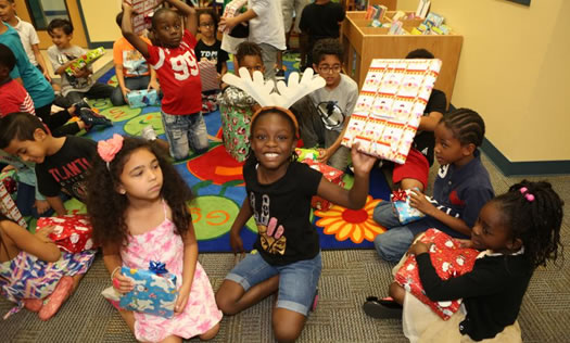 Kids with christmas presents - Tangelo Park Program