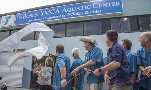 Grand reveal of Rosen YMCA Aquatic Center sign